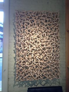 wall covering done by an artist at the Affordable Art Fair - Wooden Wall Art, Diy Wall Art, Wooden Walls, Wall Decor, Wood Sculpture, Wall Sculptures, Acoustic Diffuser, Stick Wall Art, Acoustic Design