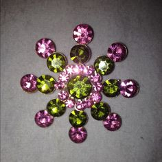 Vintage Brooch This brooch is just stunning. That's the one word that best describes it. The colors-green and pink- look amazing together. It shines so bright and will be the talk of all your friends when you wear it! Vintage Jewelry Brooches