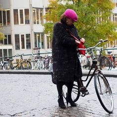 Remembering this woman in Amsterdam who brings such style to a cold and rainy day. Thank you.
