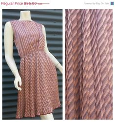 subtle pattern and knife pleats, what's not to like?  Layer over a mauve shell for the covered up look.