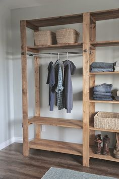 industrial style wood slat closet system with galvanized pipes diy projects