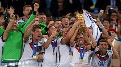 RIO DE JANEIRO, BRAZIL - JULY 13: Philipp Lahm of Germany holds the World Cup to celebrate with his teammates during the award ceremony after the 2014 FIFA World Cup Brazil Final match between Germany and Argentina at Maracana on July 13, 2014 in Rio de Janeiro, Brazil. (Photo by Lars Baron - FIFA/FIFA via Getty Images)