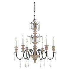 """Curving 6-light chandelier with a turned column and spear-cut crystal accents.  Product: ChandelierConstruction Material: Wood, iron, and crystalColor: Stone, black and whiteFeatures: Spear-cut crystal accentsAccommodates: (6) 60 Watt bulbs - not includedDimensions: 32.5"""" H x 27.5"""" Diameter"""