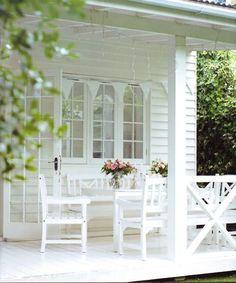All white, romantic-style porch.