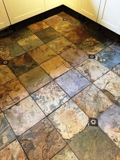 I recently visited a client living in the market town of Woodstock in Oxfordshire to rejuvenate a fantastic multi-coloured Slate floor that had been hidden under several years' worth of dirt in their kitchen. Slate is a typically hard-wearing tile used for flooring high traffic areas of houses and public buildings but does need sealing to bring out its best features and in this case the sealer had long since worn off and dirt had become ingrained in the stone.