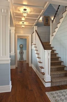 love the dark floor with the pale blue walls and white molding. gorgeous!