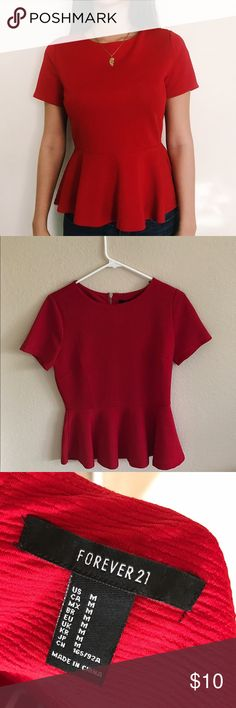 Red short sleeved top Super body flattering red shirt that zips in the back. Never worn except for the photo! Amazing condition. Pair with dark skinny jeans and heels for a chic put together look:) Forever 21 Tops Blouses