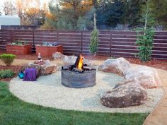A fire pit with boulder seating provides an ideal spot for casual after-dinner gatherings.