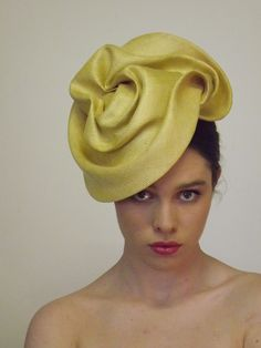 Louise Macdonald millinery remodelled from a vintage paribuntal straw.
