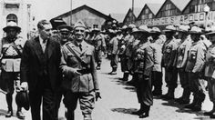 Portuguese dictator Antonio De Oliveira Salazar (1889 - 1970) reviews troops about to embark for the African colonies of the Portuguese Republic,…