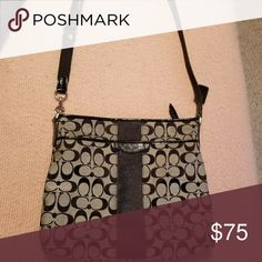 Coach purse Coach black purse in good slightly used condition. Includes free bottle of coach signature fabric cleaner which comes with its own bag and cleaning cloth. Bundle with black Coach wallet for special pricing! Coach Bags Shoulder Bags