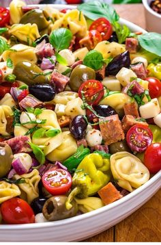 Antipasto Tortellini Pasta Salad - Host The Toast - Antipasto Tortellini Pasta Salad. This packed potluck favorite includes multiple cheeses, meats, olives, peppers, and more to create a hearty Italian-inspired summer side dish. Antipasto Salad, Appetizer Salads, Potluck Salad, Antipasto Skewers, Antipasto Platter, Fruit Salad, Italian Appetizers, Antipasta Salad Recipe, Appetizers For Bbq