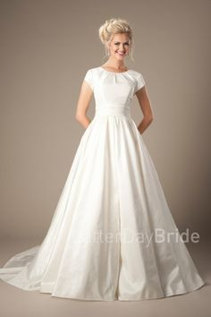 simple modest wedding dresses |  Sutherland | LatterDayBride | Under $600 | Simplicity can be stunning! This darling modest wedding gown features a ruched neckline and a flattering wrap waistline complimented by a taffeta A-line skirt.   Gown available in Ivory or White   *Pictured in Ivory  Sleeve length or neckline can be customized.  Please call for more information.