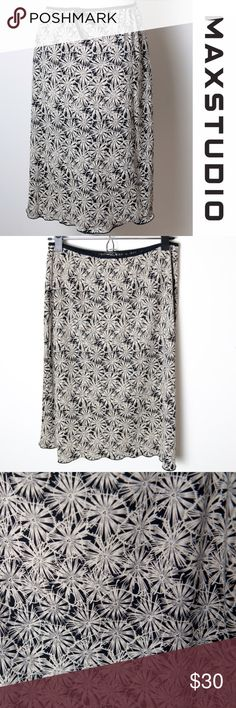 """Max Studio Tan Black Floral Skirt Medium Size medium tan and black floral skirt from Max Studio. Light weight and perfect for summer. Elastic waistband with a decorative tie in the front. Features a graphic floral pattern. 100% polyester, machine wash warm, tumble dry low, use cool iron. Approximate measurements - 27"""" waist, 23"""" long Max Studio Skirts Midi"""