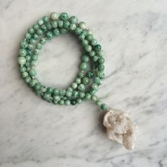Raw iridescent White Druzy Pendant on Smooth Green China Jade Bead Necklace with Sterling Silver Bead Details