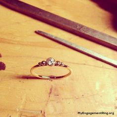 I love this ring! I wish the diamond was replaced with a cool stone or pearl though =)