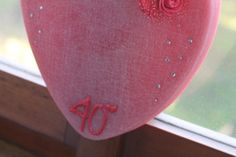 "https://flic.kr/p/ALwWCu | HEART-SHAPED DECORATION TO HANG – MADE OF WAX | Heart-shaped red decoration to hang to celebrate your ruby wedding anniversary; it's adorned with six red felt roses, a freehand red inscription ""40°"", several rhinestones, a little star adhesive and a red  ribbon to hang. In the middle you should paste a circular photo of the couple, which I cut with a zig-zag scissors. 100% natural essential oil with sweet orange fragrance. Size: 270 x 240 x 15 mm.   Handm..."
