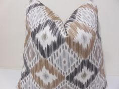 Beautiful soft pillow cover in ikat pattern. The colors are shades of fawn, brown and gray on an off white background.  Fabric: 100 %cotton  Both