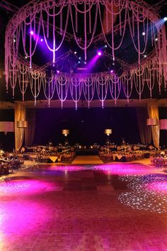 A 30' diameter pearl chandelier was created by hand strung oversized opulent pearls that created a great lighting palate.