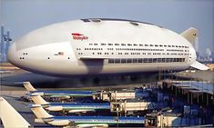 Aeroscraft...not a blimp. Takes off and lands like a helicopter, straight up and down.  One acre cabin with staterooms