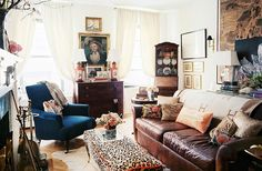 THE VIBE: Eclectic English rose. Though this living room is in a rental on the Upper East Side of Manhattan, it has the quiet allure of the English countryside. Funkier moments such as a leopard-print bench piped in orange and an Hèrmes blanket give the space its eclectic vibe, despite a number of very traditional furnishings.  IDEAS TO STEAL: Find a theme. There's a lot going on in this Manhattan living room, but a couple of themes—leopard print and dark wood—provide a bit of continuity.