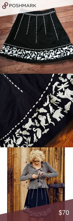 """Anthropologie Animal Crossing Stitch Skirt Very rare. EUC. Minor fading. No holes or tears. Embroidered animals scatter across a black poplin skirt. By Lithe. Side zip with one button. Cotton; cotton lining. Animals include: horse, deer, fox, swan, seahorse, fish, dragonfly, dolphin, duck, and squirrel. 21"""" long, 15.5"""" waist laid flat. Can fit a medium. Last photo: Waist is cinched in the back. My dress form (mannequin) is a small and this skirt was too big for it. Anthropologie Skirts…"""