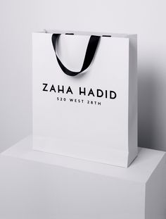 Saved by Jules Tardy (julesinthebox). Discover more of the best Branding, Zaha, Hadid, Bag, and Logo inspiration on Designspiration Shopping Bag Design, Shopping Bags, Paper Bag Design, Retail Bags, Heart Tattoo Designs, Perfume, Paper Tags, Zaha Hadid, Identity Design
