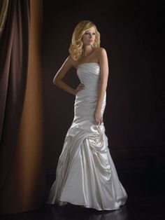 Heavenly tucks and swirls of satin make Allure Romance 2257 a glorious wedding gown. Strapless and delightful, the ruching is absolutely divine as this fit and flare gown will turn heads and make you feel like the bride of the season. #timelesstreasure