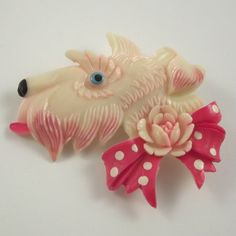 This fancy Scottie dog pin is made of celluloid.