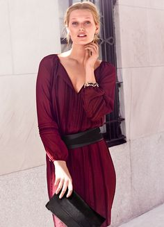 Sheer sleeves complement the charming aesthetic of this soft chiffon dress. A keyhole neckline with free-spirited tassel ends makes the ultimate bohemian statement. Stylist Note: Define your waist with a wide earthen belt.   White House Black Market