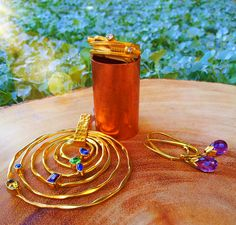 Geometric Stone Circle Pendant #Pendant #IndiaInspired #Vermeil 18K Vermeil Karma Twist Ring #Vermeil #Ring #IndiaInspired Jaipuri Circular Gemstone Drop Earrings #Vermeil #Amethyst #Earrings