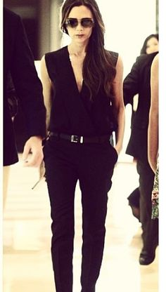 """VB wearing a Jumpsuit. So perfect with the belt. It helps streamline the look."" She's an icon"