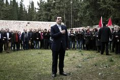 Greece's newly-appointed Prime Minister Alexis Tsipras places his hand on his heart during a ceremony at the Kessariani shooting range site where hundreds of members of the Greek Resistance were executed by Nazi occupation forces during World War II in Athens, January 26, 2015.REUTERS/Alkis Konstantinidis