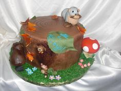 baby shower nature cake,, creatures are made of rice krispies then covered in modeling chocolate and fondant,juliescakes.com