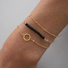 Delicate gold stacking bracelet set, with fine gold chain and black onyx