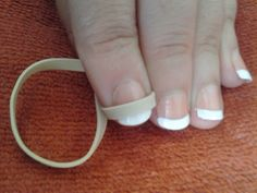 French Manicure At Home. Tip: use rubber band as a guide. Simple idea that works.