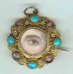 Georgian miniature lovers eye in gold with pink sapphires & turquoise frame.
