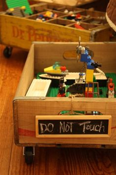 Lego storage in an old soda crate - from Holly Mathis Interiors