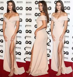 "Bella Hadid accepts GQ's ""Model of the Year"" Award in metallic, gold sandals on September 6, 2016 at Tate Modern in London."