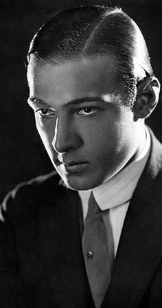 Rudolph Valentino (1895-1926), French / Italian-born stage actor, dancer, dance-teacher and global sex symbol of 1920s silent films whose smouldering sensuality drove his female fans wild; born Rodolfo Alfonso Raffaello Pierre Filibert Guglielmi di Valentina d'Antonguella in Castellaneta, Italy; in 1922 he was on a salary of $350 per week, by 1923 it was $7,500 with creative control. At his New York funeral procession, 100,000 people lined the streets.