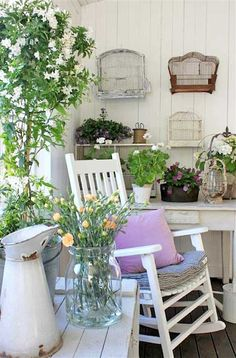 love this porch setting..white rocker posies and chippy granite pitcher.....