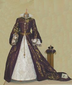 Replica of Mary's wedding dress. Mary's dress was described as: Consisting of a mantle of brocaded cloth of gold, bordered with pearls and diamonds of great size, and lined with ermine. The dress was also gold smothered with the same precious stones, and the underskirt of white satin embroidered of silver. The French hood in black velvet was surmounted by a double row of large diamonds.