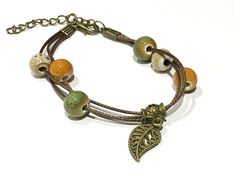 Bracelet, leather and ceramic beads, leaf charm.
