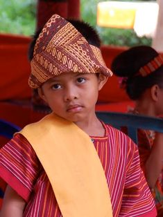 Torajan boy in ceremonial attire from Cultural Travel in Tana Toraja, Sulawesi, Indonesia