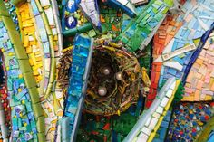 """Detail of """"Primavera"""" (Spring) by Giuilo Menossi 2012  100 x 100 cm  Smalti, vitreous glass, pearls, millefiori, small branches, Lego pieces."""
