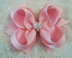 This Light Pink Boutique Girls Hair Bow with Sparkly Heart is very unique and carries a distinctive elegance and delicate charm. It is the