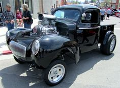 Willy's pickup with a blown big block. Straight axle. Short drive line. Wheelie bars.