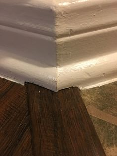 Rustic laminate with baseboard detail home improvement for Hardwood floors quarter round