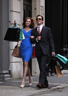 Sara Ellis and Neal Caffery from White Collar technically he is George Devore and I can't remember who she is she is George's wife