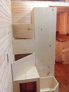"Bear Creek Carpentry Company - posted these stairs on facebook in December 2014.  Smaller footprint in home while still having stairs! ""Building a spiral staircase, with storage inside of treads, base for water storage system, and a wardrobe......we will be able to build these as components to go in other Tiny Houses.....treads will be solid 5/4 radius edged oak stained and polyed to match the prefinished floor........."""